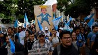Guatemalans march demanding the resignation of President Jimmy Morales and in support of the head of the CICIG, Colombian Ivan Velasquez, who is investigating corruption in the country, in front of the Culture Palace in Guatemala City, on 26 August 2017 Johan Ordonez/AFP
