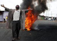 "A supporter of the opposition leader Raila Odinga in the Kibera slum in Nairobi, Kenya. It is often said, ""When Kibera burns, so does Kenya."" Credit Goran Tomasevic/Reuters"