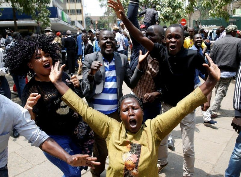 Supporters of opposition leader Raila Odinga cheer outside court on Sept. 1 after President Uhuru Kenyatta's Aug. 8 election win was declared invalid in Nairobi. (Baz Ratner/Reuters)