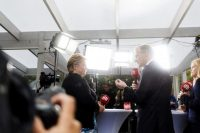 Norwegian Prime Minister Erna Solberg, left, listens as Jonas Gahr Store, leader of Norway's Labor Party, speaks during a televised political debate Sept. 6. Norwegians head to the polls Sept. 11 to elect a new government. (Kyrre Lien/Bloomberg)