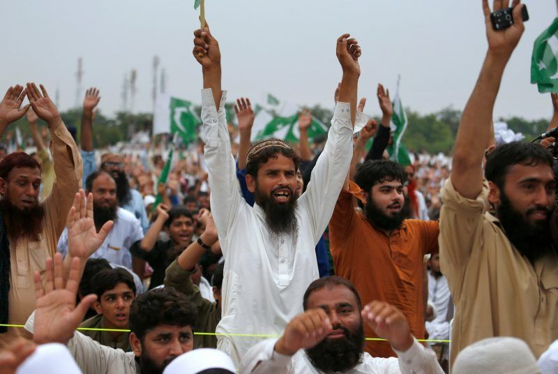Supporters of Jamaat-ud-Dawa, an arm of the banned Pakistani terrorist group Lashkar-e-Taiba, at a rally in Islamabad in July. Jamaat-ud-Dawa recently sought to register a political party, but was rebuffed. Credit Anjum Naveed/Associated Press