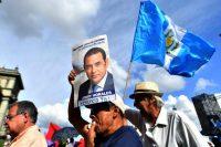 Una manifestación para exigir la renuncia del presidente Jimmy Morales en Guatemala, el 26 de agosto Credit Johan Ordonez/Agence France-Presse — Getty Images