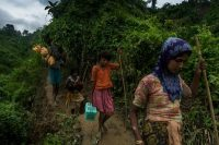 Rohingya refugees from Myanmar crossed the border into Bangladesh after days of walking to escape violence in their villages. Credit Adam Dean for The New York Times