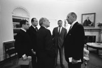 Walt Rostow, third from left, speaking to Lyndon Johnson in the Oval Office in 1967. Between them, in the background, is Robert McNamara. Credit LBJ Presidential Library
