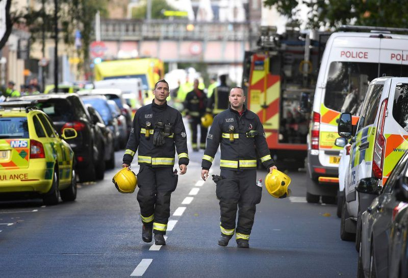 Emergency workers at the scene of the terror attack in London on Friday. Credit Stefan Rousseau/Press Association, via Associated Press