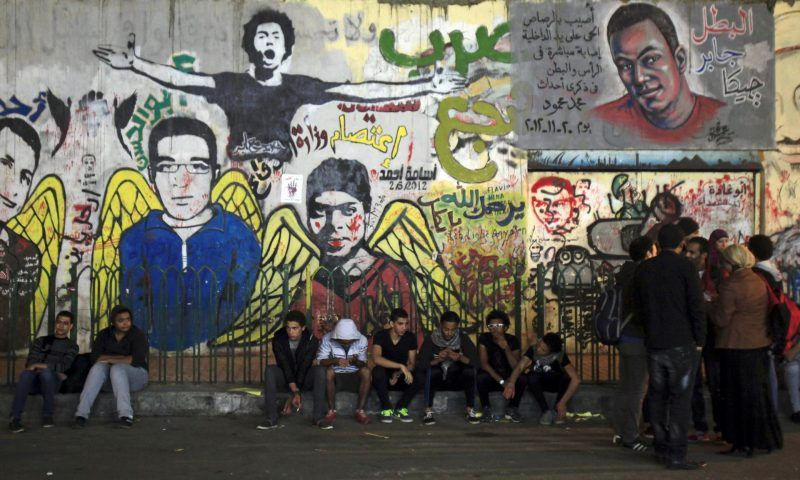 'The Arab world could really benefit from a good dose of Milton.' Anti-government protesters in front of revolutionary graffiti, Cairo, 2013. Photograph: Amr Dalsh / Reuters/Reuters