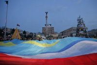 Ukrainian, Crimean and Crimean Tatar flags during a rally in support of Ukraine's territorial integrity, in Kiev's Independence Square in 2014. (Efrem Lukatsky/AP)