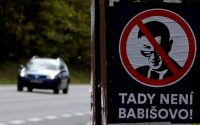 "A poster depicting Andrej Babis hangs on a bus stop near the town of Benesov, Czech Republic. It says, ""This is not Babis's land."" (David W. Cerny/Reuters)"