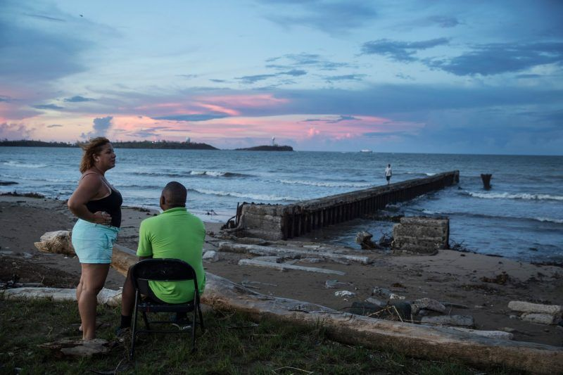 Puerto Rico at sunset, two weeks after Hurricane Maria devastated the island. Credit Victor J. Blue for The New York Times