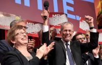 Austrian presidential candidate Alexander Van der Bellen celebrates with supporters at a post-election event in Vienna in 2016. (AFP/Getty Images)