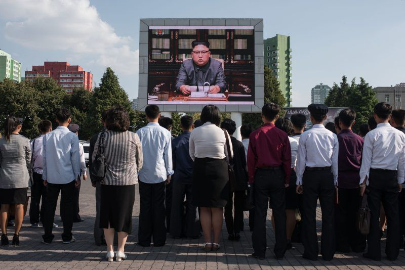 Ed Jones/AFP/Getty Images. North Koreans watching a news broadcast of their leader, Kim Jong-un, speaking about the country's nuclear program, Pyongyang, September 22, 2017