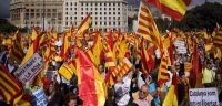 BARCELONA, SPAIN - OCTOBER 12: Anti-separatist Catalans hold Spanish and Catalan flags during a demonstration on Spain National Day on October 12, 2012 in Barcelona, Spain (Photo by David Ramos/Getty Images).