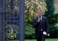 Czech billionaire Andrej Babis adjusts his tie after meeting with Czech Republic's president, Milos Zeman, at the Lany Castle in Lany, Czech Republic. (AP)