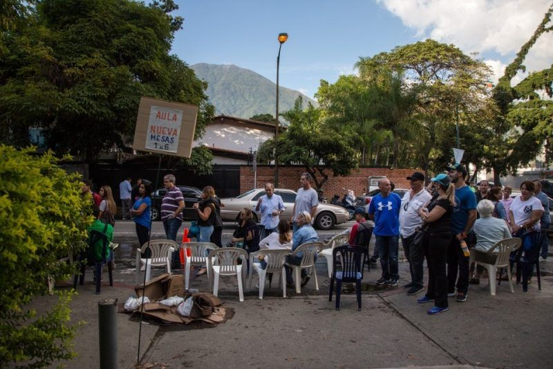 Voters wait in line outside a Caracas polling center during Venezuela's elections for state governors Oct. 15. The regime of President Nicolás Maduro claimed wins in 17 of the 23 states, results that defied polls predicting widespread wins by opposition candidates. (Wil Riera/Bloomberg)