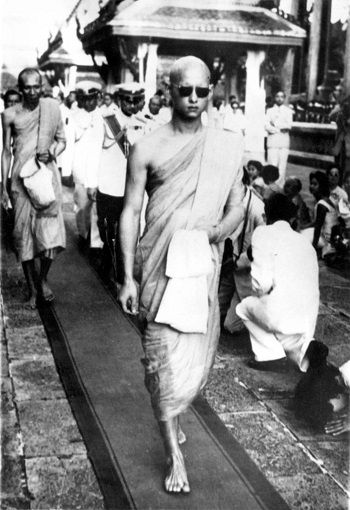 King Bhumibol leaving a Buddhist temple in Bangkok after being ordained a monk for two weeks in 1956. Associated Press