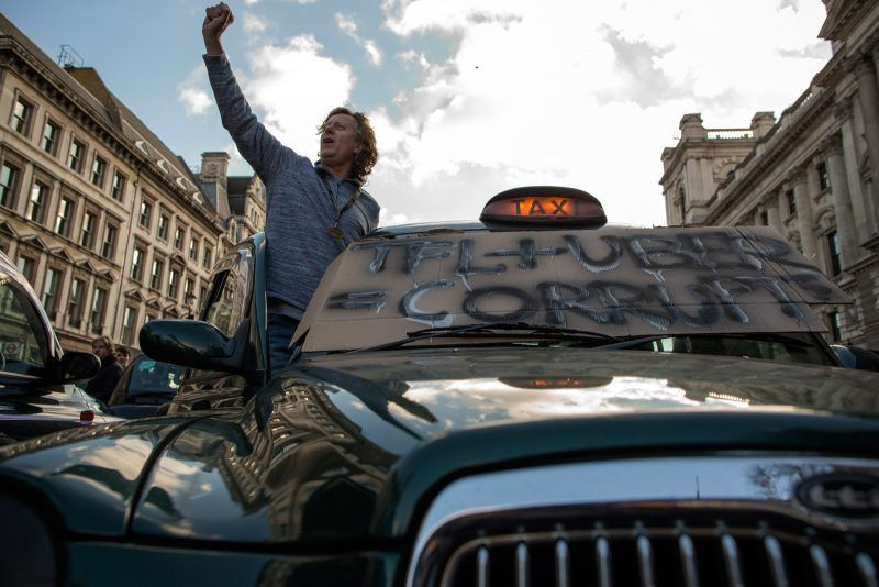Dan Kitwood/Getty Images. A London black-cab taxi driver at a protest against Uber, London, February 10, 2016