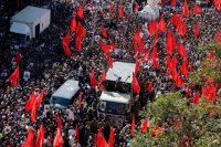 Mourners escort the truck carrying the coffin of Gen. Hossein Hamedani, a commander in Iran's Revolutionary Guard Corps, during his funeral procession in Tehran on Oct. 11, 2015. The general was reportedly killed on Oct. 8, 2015, by the Islamic State on the outskirts of Aleppo, Syria. (Abedin Taherkenareh/European Pressphoto Agency)