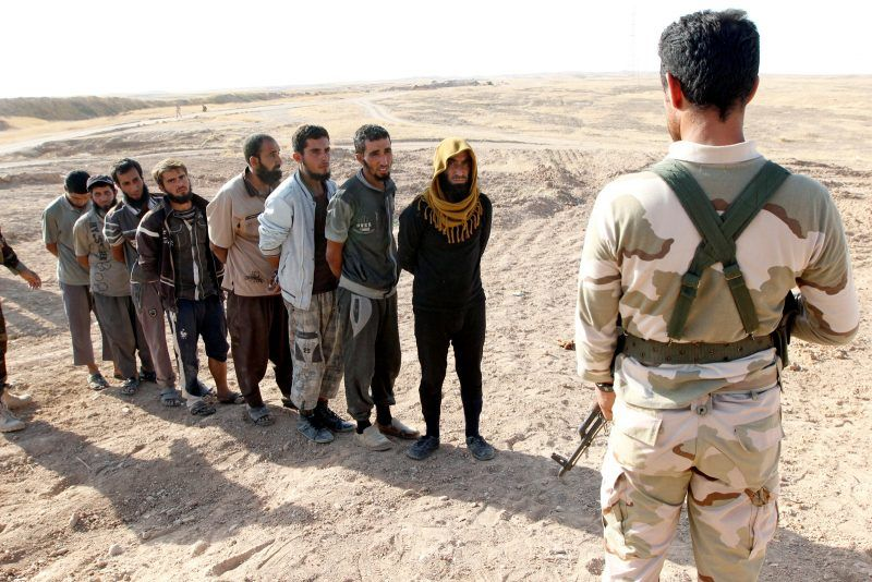 Ako Rasheed TPX/Reuters. A member of the Kurdish Peshmerga detaining ISIS militants, southwest of Kirkuk, Iraq, October 5, 2017