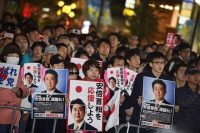 People listen to a speech by Prime Minister Shinzo Abe during an election campaign in Tokyo on Oct. 20. (Kazuhiro Nogi/AFP/Getty Images)