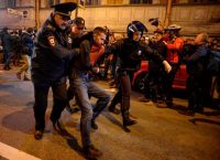 Olga Maltseva/AFP/Getty Images. Russian police officers detaining a supporter of opposition leader Aleksei Navalny during an unauthorized rally in St. Petersburg, October 7, 2017