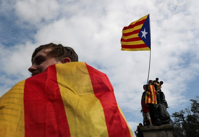 Susana Vera/Reuters. People wave a Catalan separatist flag after the banned independence referendum in Barcelona, October 2, 2017