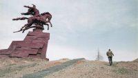 A man walks past a monument depicting Kyrgyz folklore hero Manas in Batken, Kyrgyzstan, in March 2016. CRISIS GROUP/Julie David de Lossy