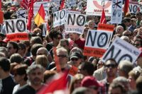 Demonstrators wave signs against social cuts during a protest organized by Spanish trade unions in Madrid on Oct. 7, 2012. (Angel Navarrete/Bloomberg)