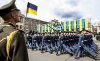 Ukrainian soldiers marching in a military parade in Kiev on Independence Day in August. Credit Mykhailo Markiv\TASS, via Getty Images