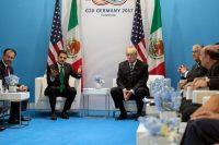 El presidente de México, Enrique Peña Nieto, con el presidente estadounidense Donald Trump durante el G20 en Hamburgo, Alemania, en julio Credit Stephen Crowley/The New York Times