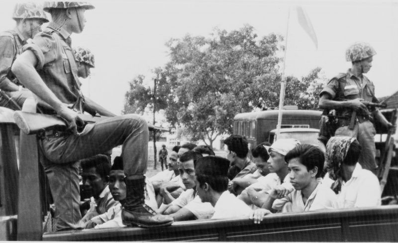 AP Images. Soldiers taking suspects to prison during an anti-Communist crackdown in which some 500,000 Indonesians were killed, Jakarta, October 30, 1965