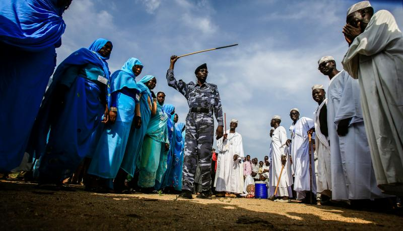 A Sudanese soldier walks in a procession during President Omar al-Bashir's tour in Darfur on 21 September. Photo: Getty Images.