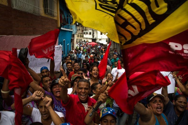 Government supporters rally near a relocated polling center on Oct. 15, 2017, in Caracas ahead of state-governor elections in Venezuela's 23 states. The results are in dispute. (Wil Riera/Bloomberg News)