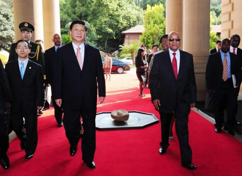 In this 2013 file photo, South African President Jacob Zuma (R) receives China's President Xi Jinping (L) in Pretoria, South Africa. (EPA/GCIS)