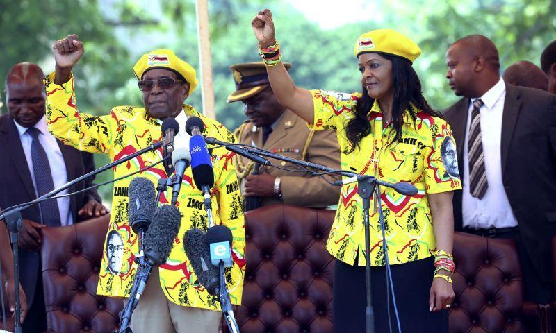 President Robert Mugabe and Grace Mugabe during a solidarity rally in Harare. Photograph: AP