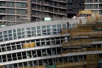 Construction on the West Kowloon railway terminus station in Hong Kong, slated to open in late 2018. Plans are underway to place an immigration and customs checkpoint inside that would be operated by mainland China security personnel and enforce Chinese law. Credit Bobby Yip/Reuters