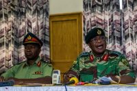 Zimbabwe Army General Constantino Chiwenga, right, and Valerio Sibanda address a news conference held at the Zimbabwean Army Headquarters. (AFP/Getty Images)