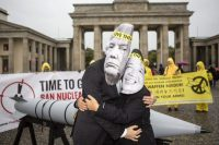 Protesters wore masks to look like President Trump and Kim Jong-un during a demonstration organized by the International Campaign to Abolish Nuclear Weapons in Berlin in September. Credit Omer Messinger/Getty Images
