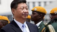 Xi Jinping arrives to a guard of honour in Harare in 2015. Photo: Getty Images.