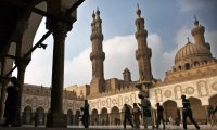 Worshipers arrive for Friday prayers at al-Azhar mosque in Cairo on Dec. 28, 2012. (Khalil Hamra/AP)