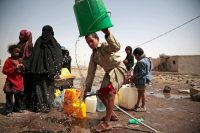 A boy rinses a bucket for collecting well water that is believed to be contaminated with the bacteria that causes cholera, on the outskirts of Sana, Yemen, in July. Credit Hani Mohammed/Associated Press