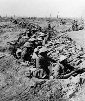 British infantrymen occupy a shallow trench in a ruined landscape before an advance on the first day of the Battle of the Somme, on July 1, 1916. One of the most vicious conflicts of World War I, the battle raged across northern France. By its close on Nov. 18, millions of men had battled through the mud and blood of the treacherous trenches on both sides. (AP/PA)