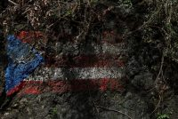 La bandera de Puerto Rico en la ladera de una montaña cerca de la municipalidad de Morovis, en las afueras de San Juan, el 10 de octubre crédito Shannon Stapleton/Reuters