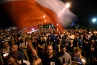 People in Warsaw protest proposed changes to the Polish judiciary in July. The proposed change is being discussed again. (Bartlomiej Zborowski/European Pressphoto Agency)