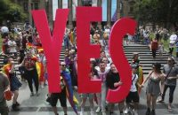People celebrate after the announcement of the same-sex marriage postal survey result in front of the State Library of Victoria in Melbourne, Australia on Nov. 15. (David Crosling/AAP Image via Associated Press)