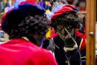 A woman paints her face as she dresses up as Zwarte Piet (Black Pete) in Soest, the Netherlands, in October 2013. (EPA/Robin Van Lonkhuijsen)