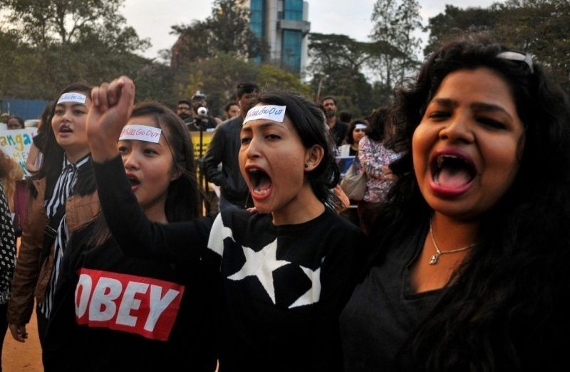 Women shout slogans as they take part in the #IWillGoOut rally, to show solidarity with the Women's March in Washington, along a street in Bengaluru, India, on Jan. 21, 2017. (REUTERS/Abhishek N. Chinnappa)