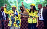 Zimbabwe's President Robert Mugabe and his wife Grace chant the party's slogan during a solidarity rally in Harare on Nov. 8. (AP)