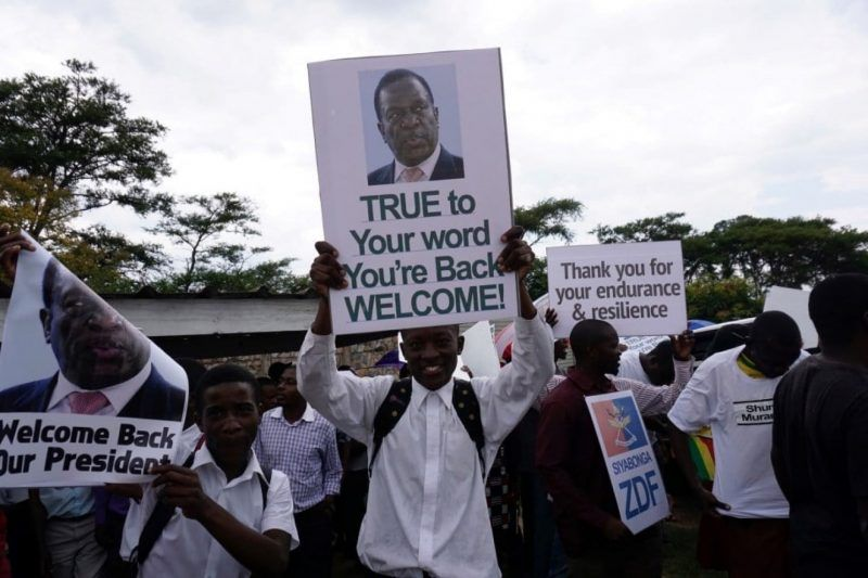 People gather outside Harare's airport to welcome former Zimbabwean vice president Emmerson Mnangagwa on Nov. 22, in Harare. Mnangagwa, 75, was sacked by President Robert Mugabe on Nov. 6, infuriating army chiefs and triggering events that led to Mugabe's ouster. (Zinyange Auntony/AFP/Getty Images)