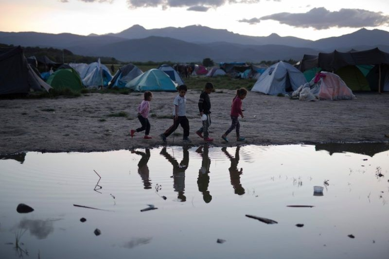 Children play in a makeshift refugee camp of the northern Greek border point of Idomeni, Greece, in May 2016. (AP)