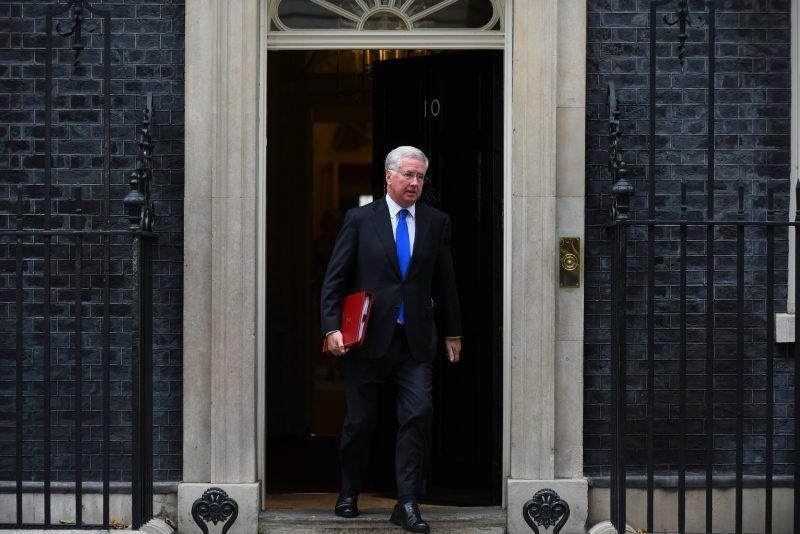 Michael Fallon leaving 10 Downing Street last week. He stepped down as defense secretary on Wednesday. Credit Alberto Pezzali/NurPhoto, via Getty Images